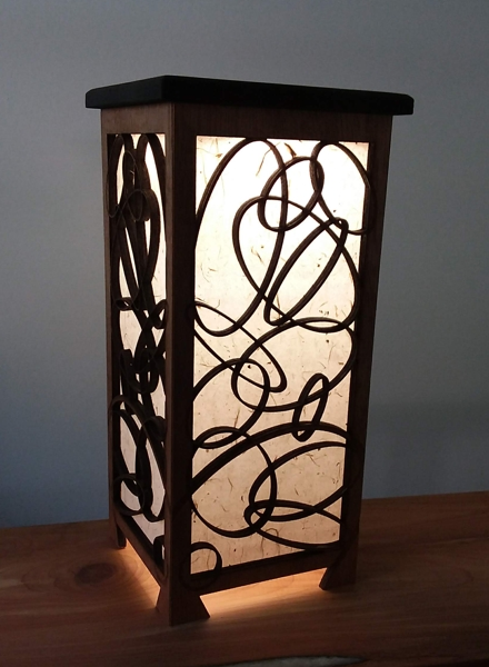 Shoji lamp with overlapping ellipses design